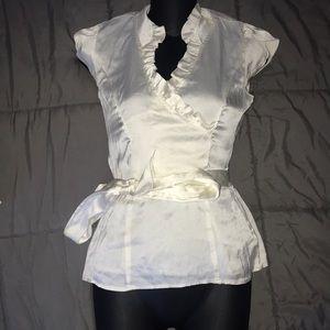 Cream color blouse size xxs.